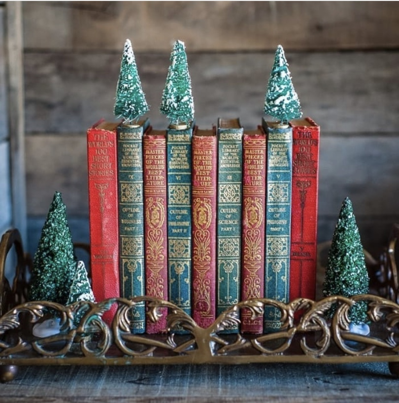 Stack of red and green books with Christmas trees