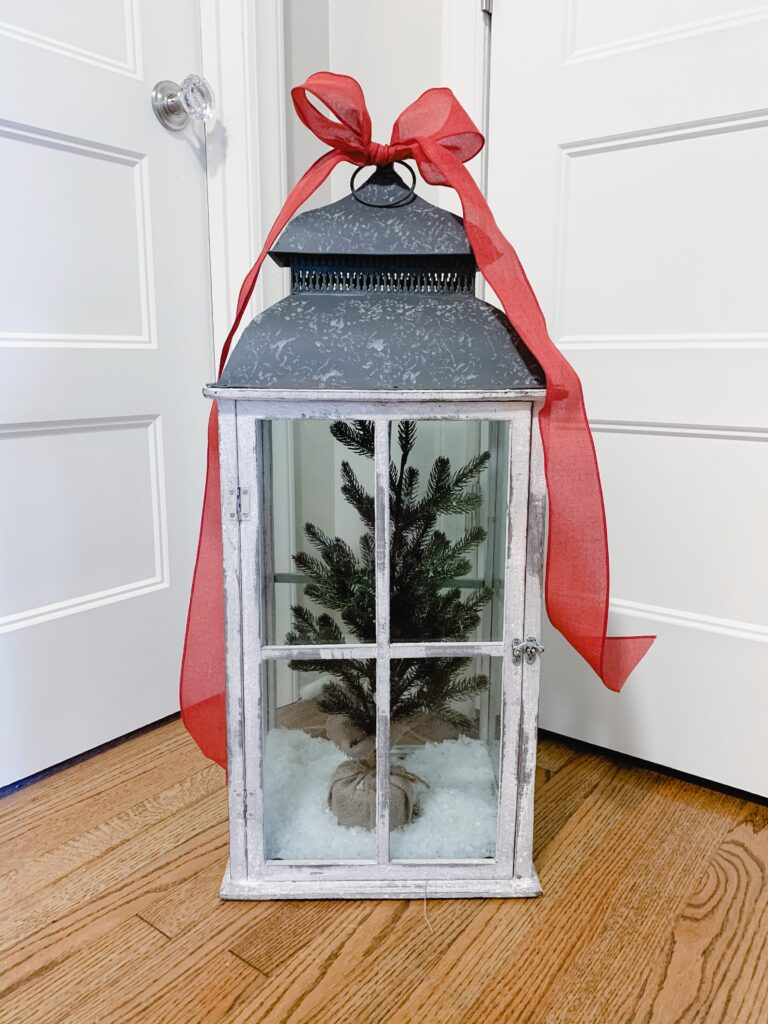 Large lantern decorated with a Christmas tree