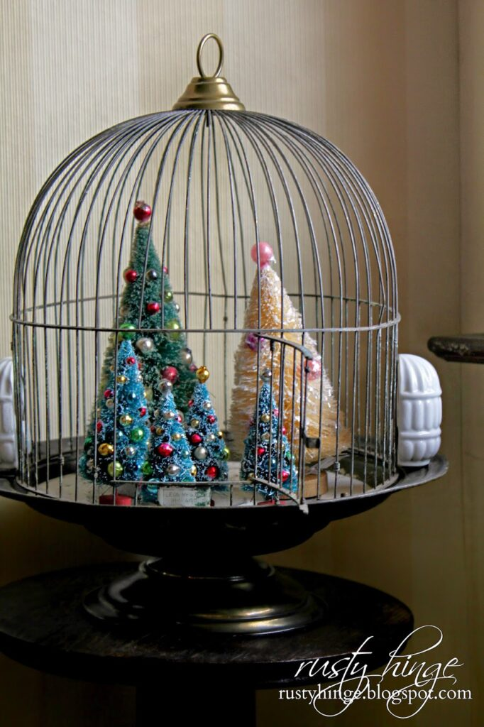 Christmas trees in a bird cage