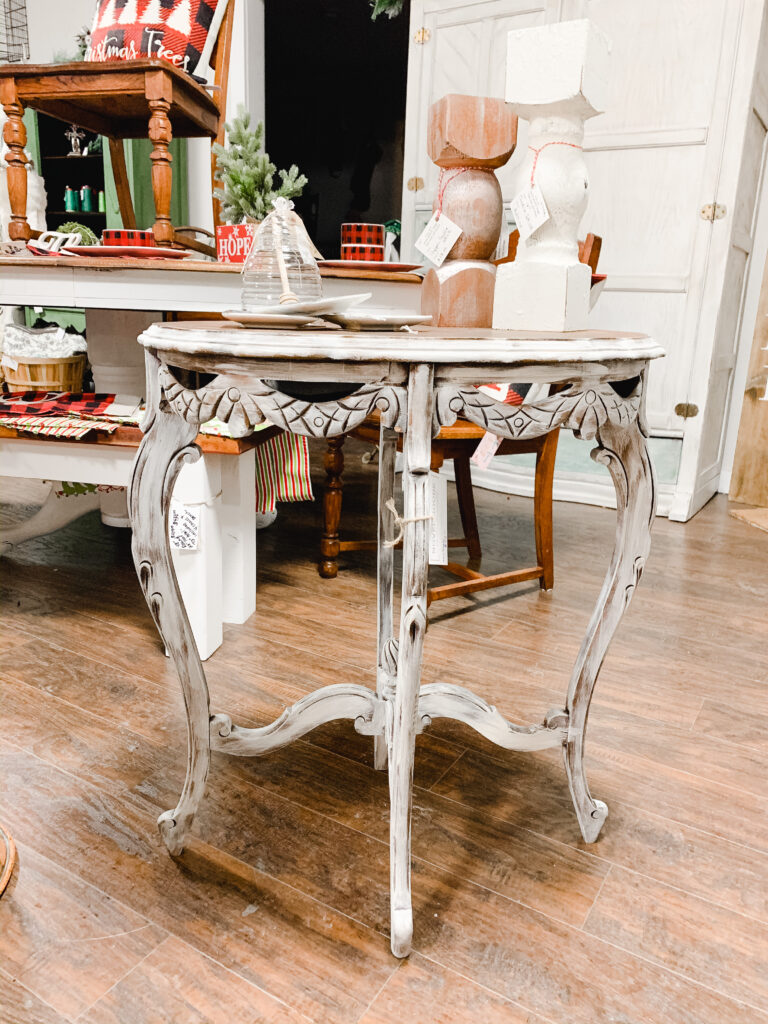 Refinished antique table with gingerbread trimmed with white dry brushed finish