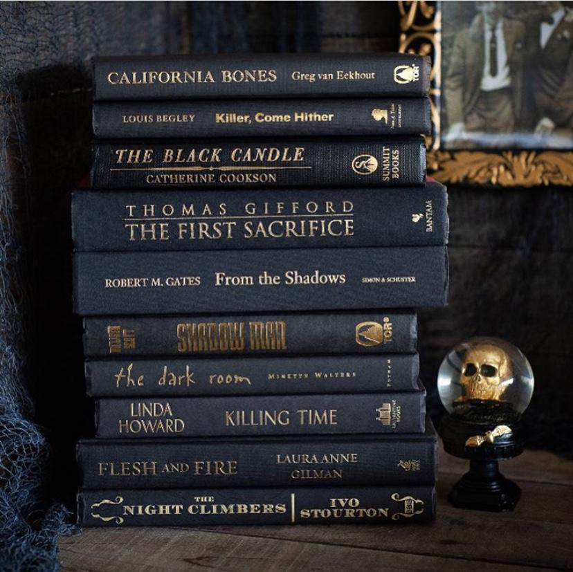 Stack of black Halloween inspired books