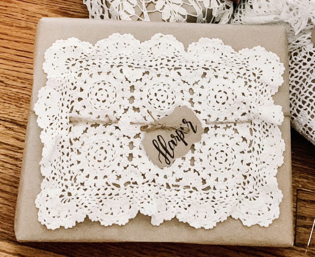 Doily topper on a brown paper package