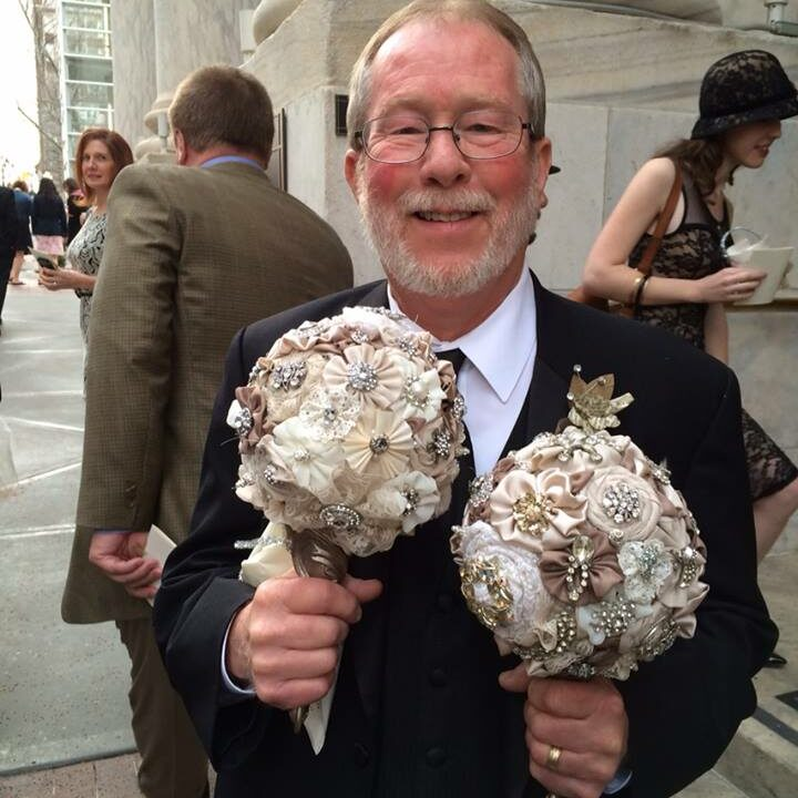 Dad holding brooch bouquets