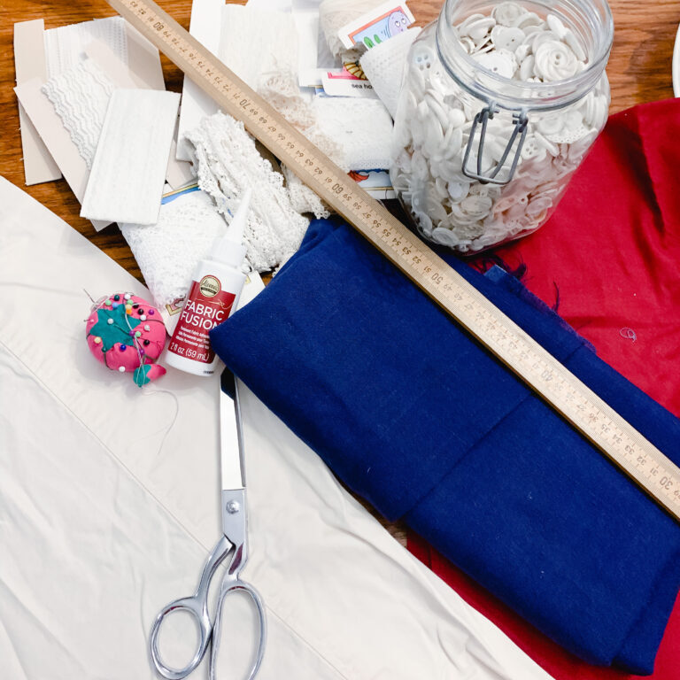 Supplies to make a lace and scrap flag
