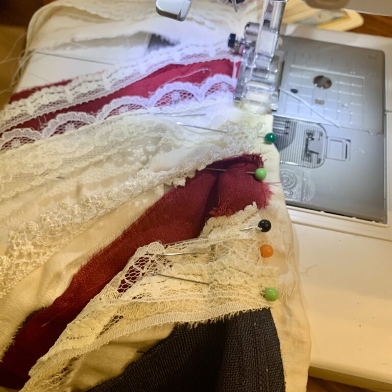 Sewing the lace and scrap flag