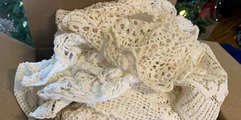 Box full of doilies collect after opening gifts