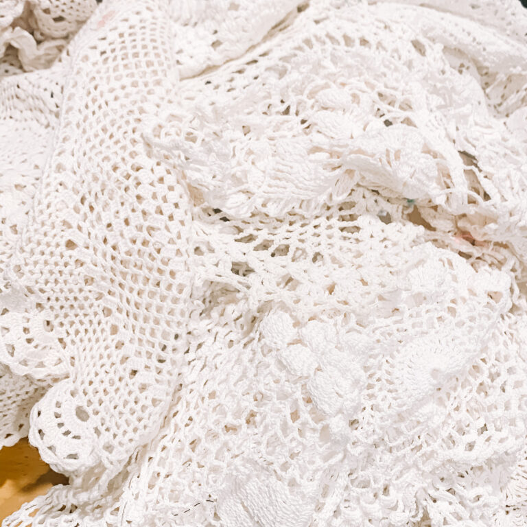 Pile of vintage doilies for gift wrapping