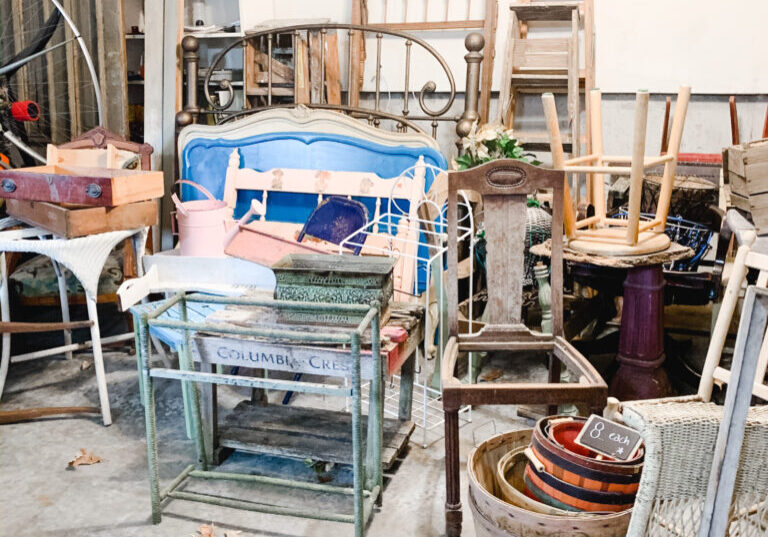Garage of the saltbox house filled with antiques