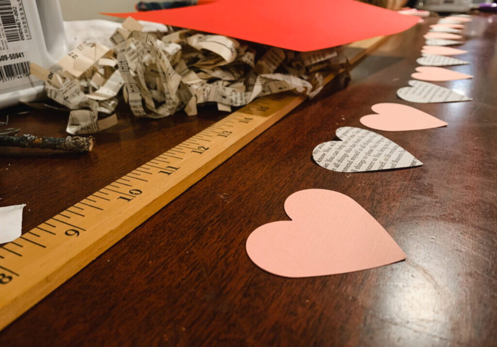 Alternating pink and book page hearts for a Valentine's Day garland