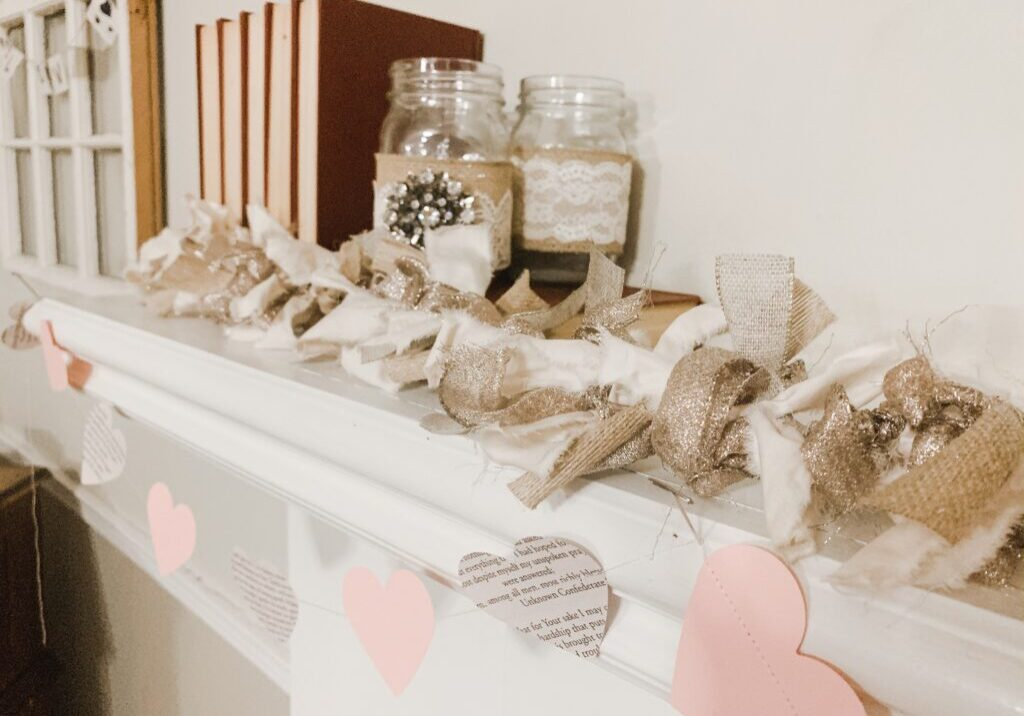 DIY paper heart garland with book pages and pink card stock