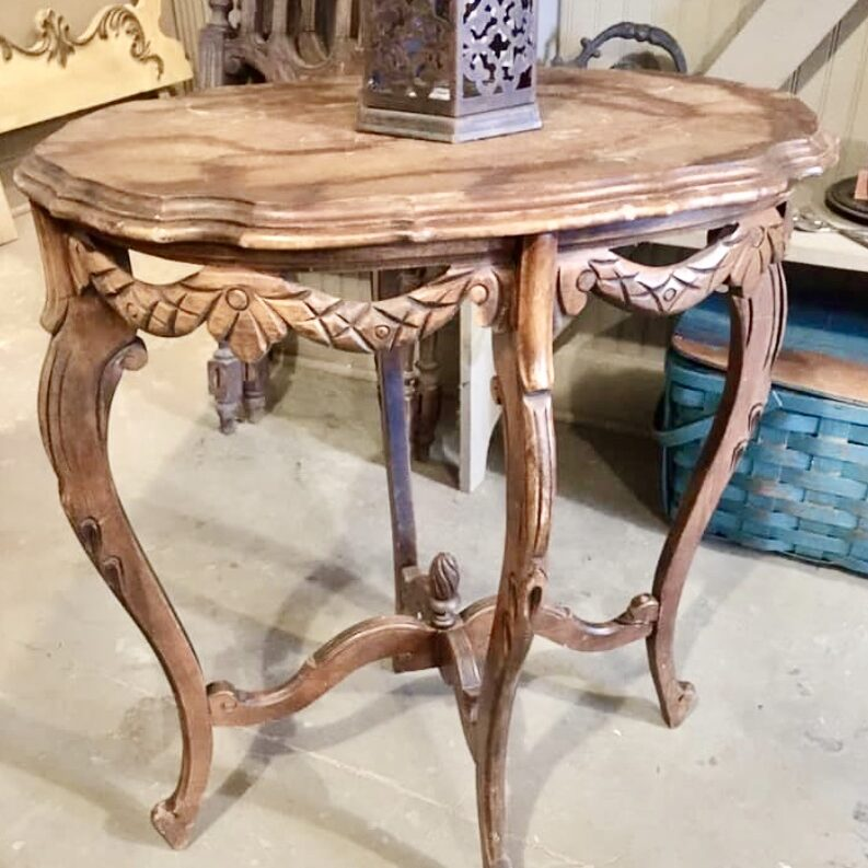 Antique oval gingerbread table